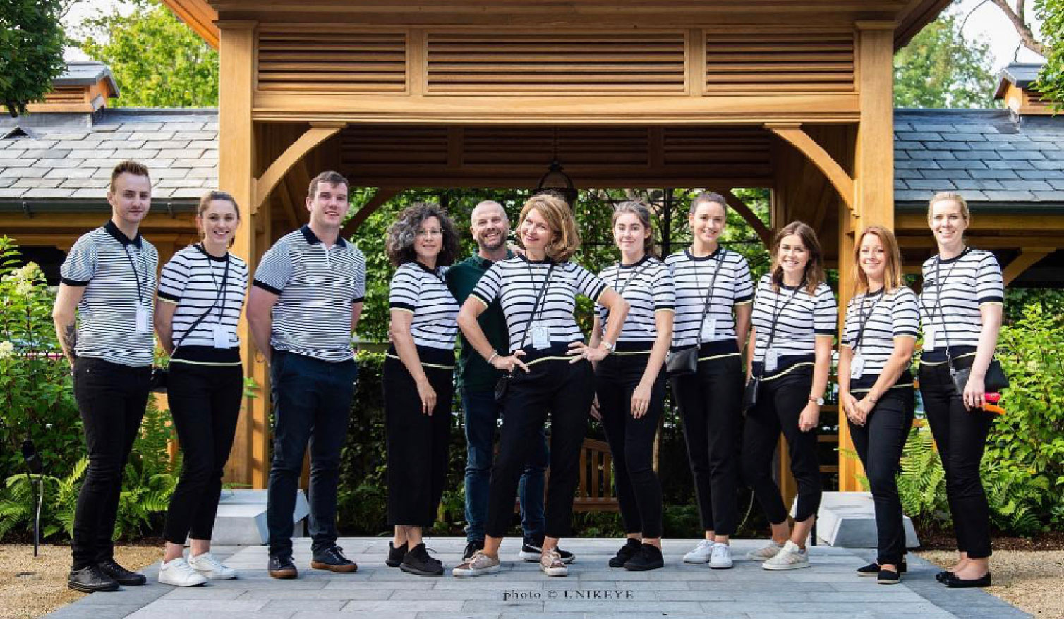 Tara Fay and her team dressed in striped tops and black pants.