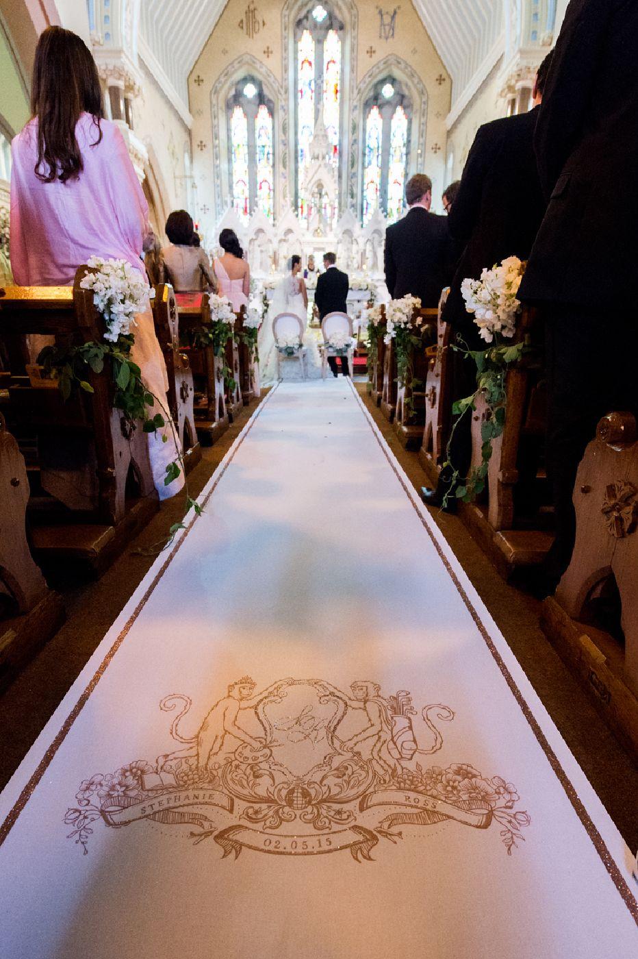 Monogramed isle during wedding ceremony.