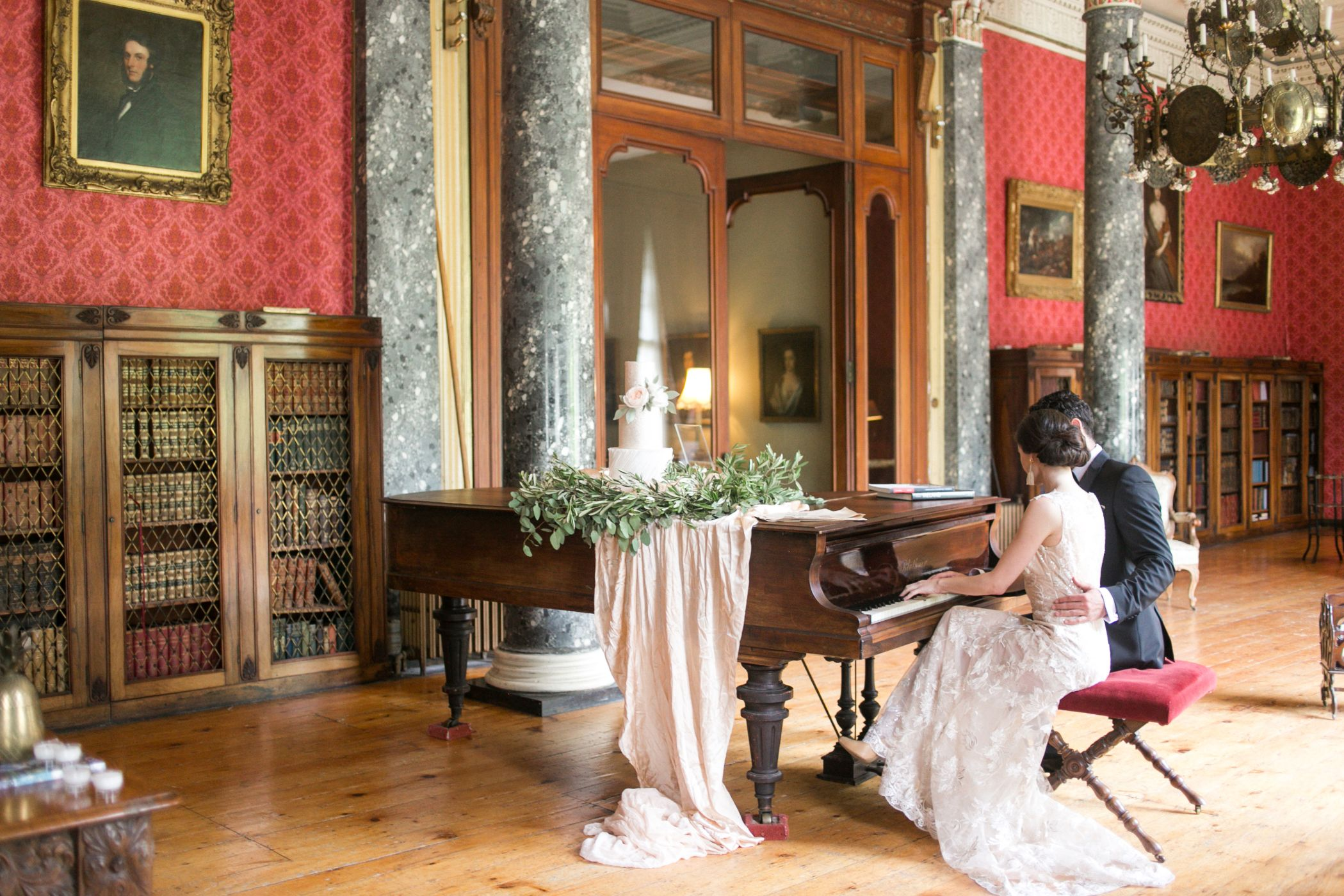 Bride and groom at a piano prior to wedding ceremony.