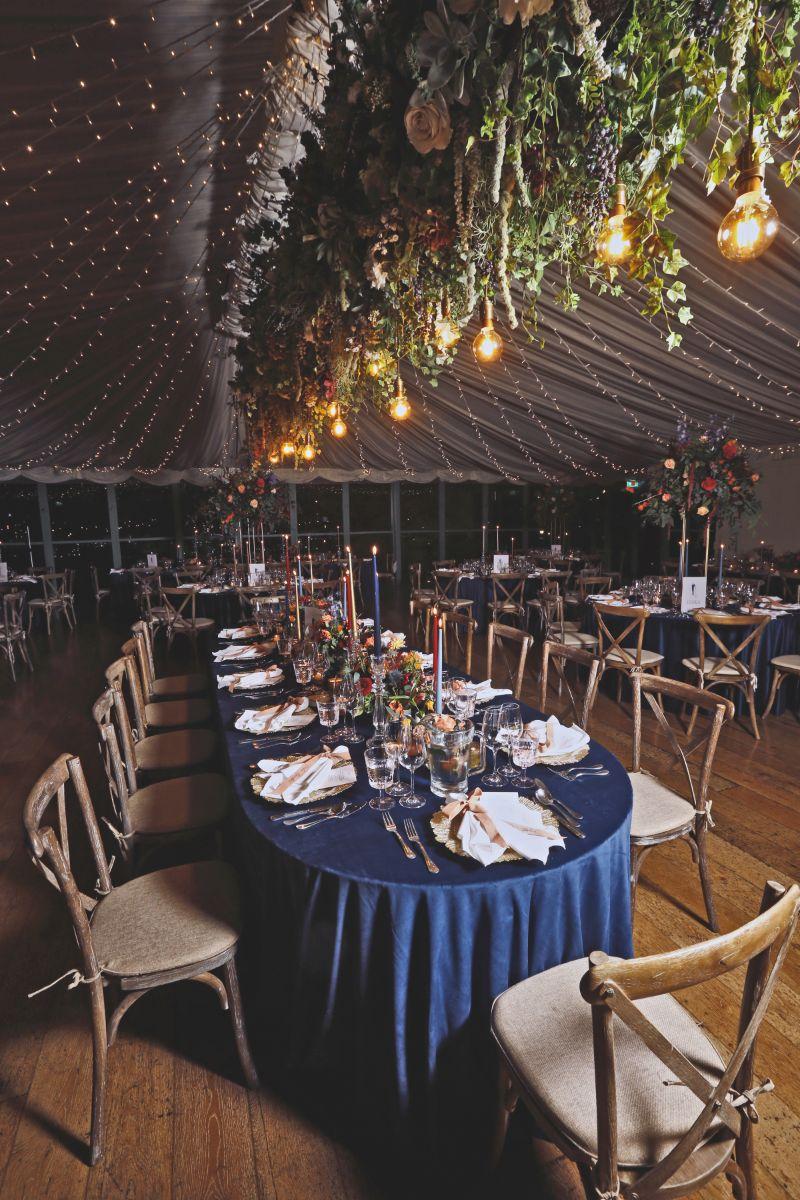 Romantically lit tent reception.