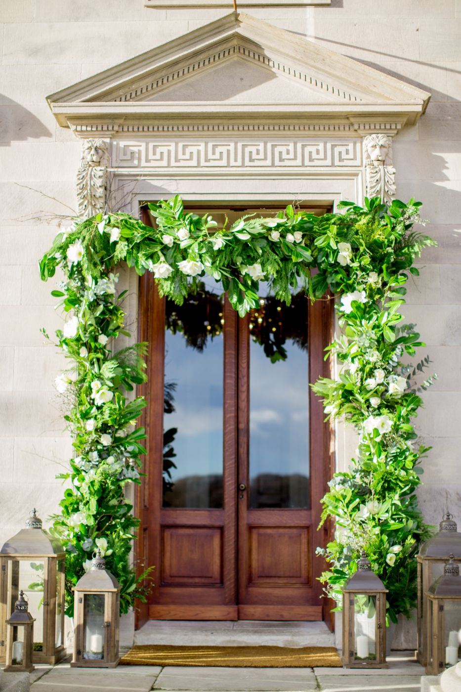 Ivy and flowers surrounding church entrance before wedding.