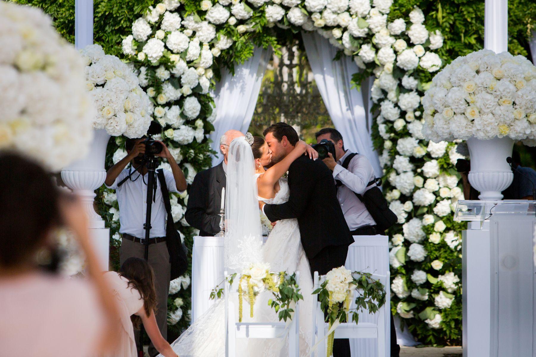 Bride and groom embracing following wedding.