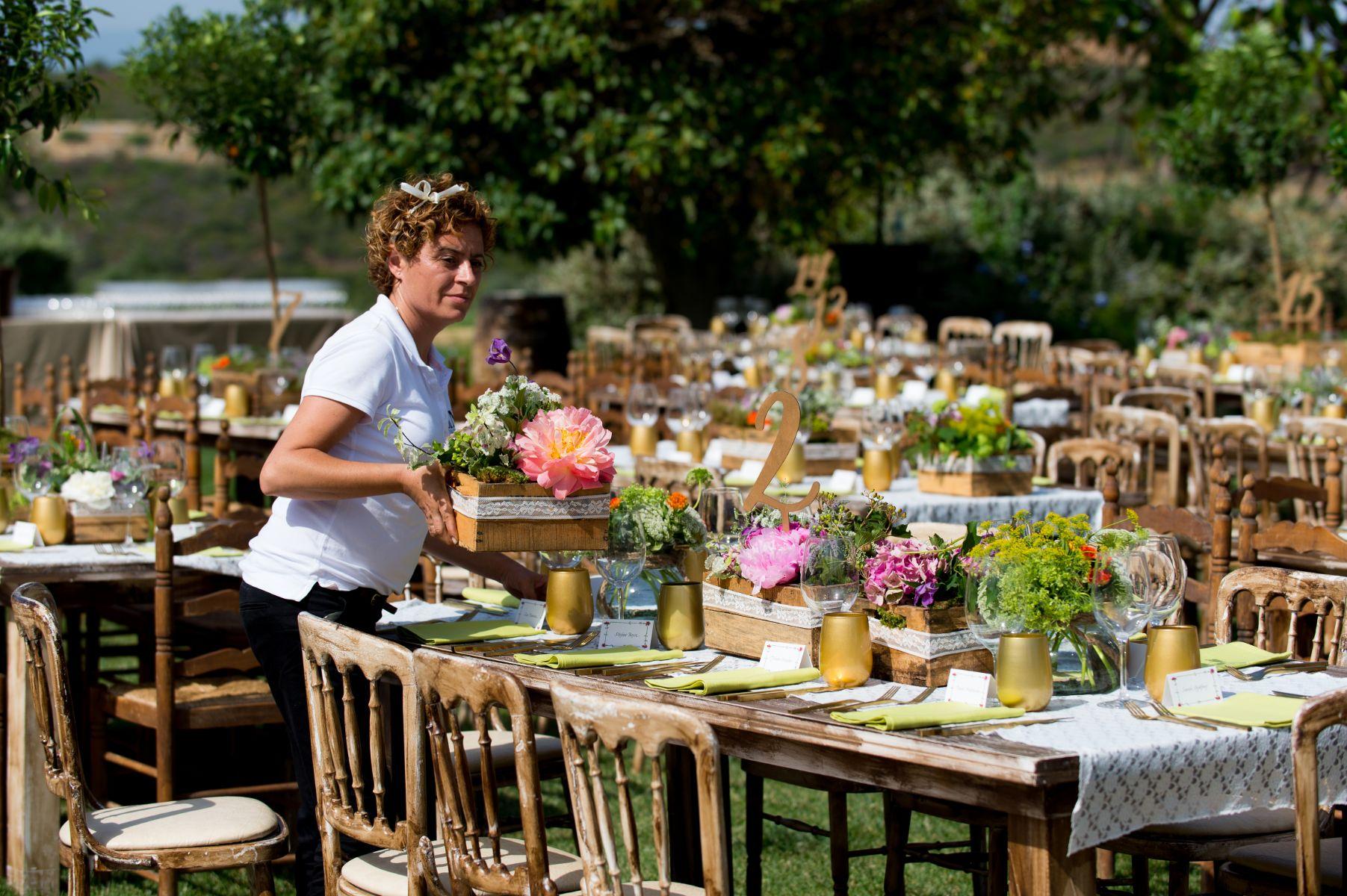Helpers preparing the wedding reception.