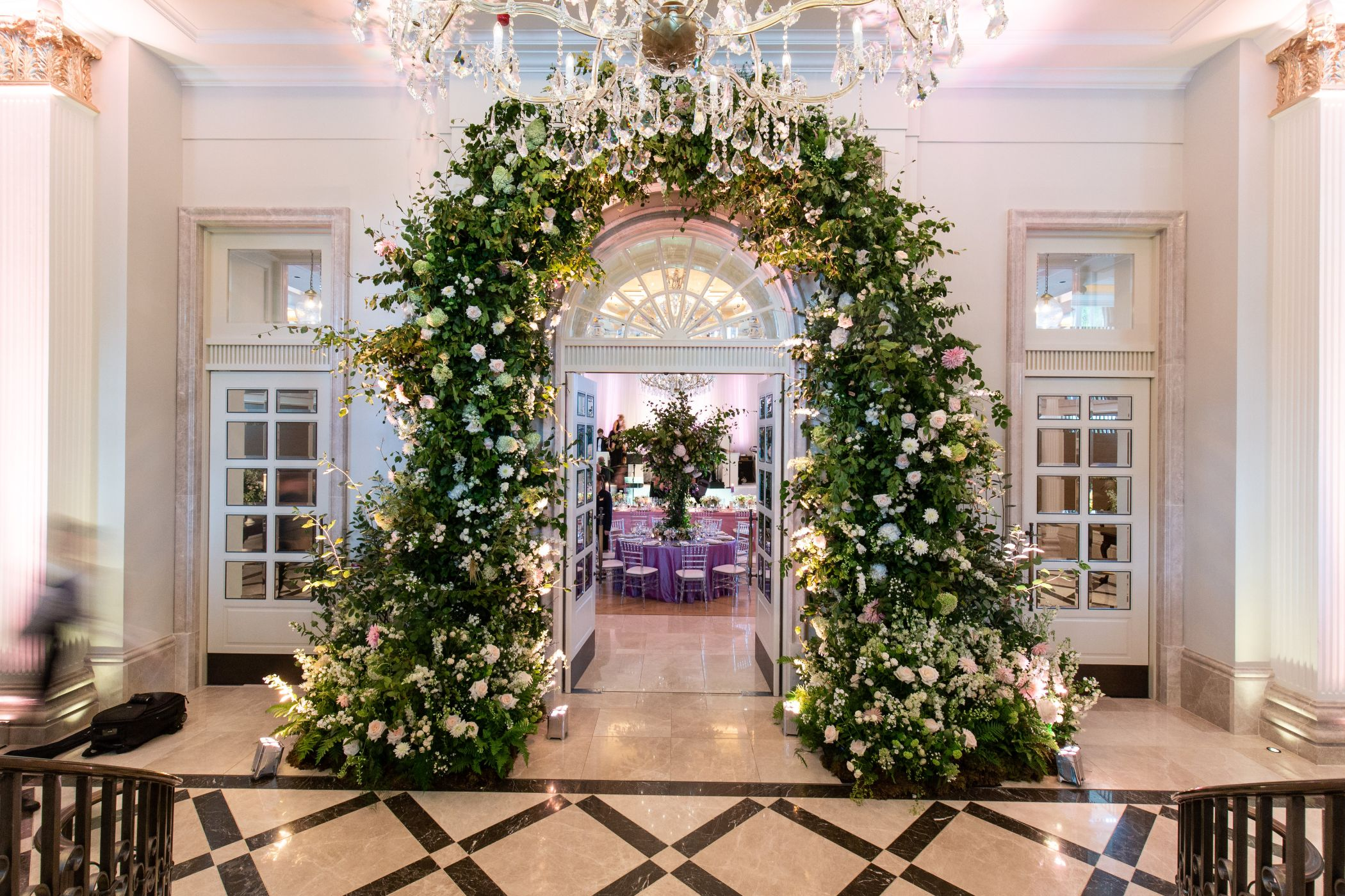 Floral arch leading to wedding reception.