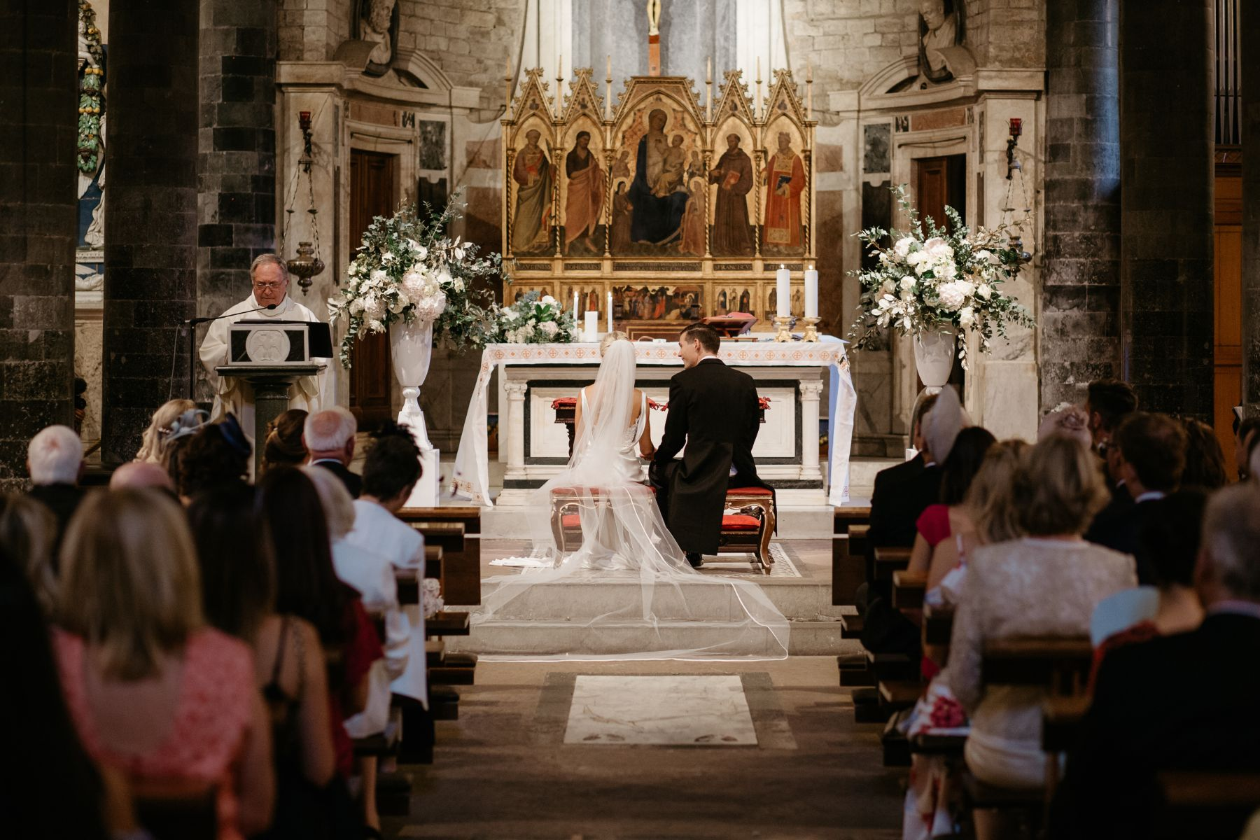 Bride and groom during ceremony in cathedral.