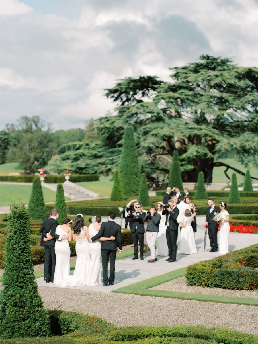 Wedding party outside a beautiful castle garden.
