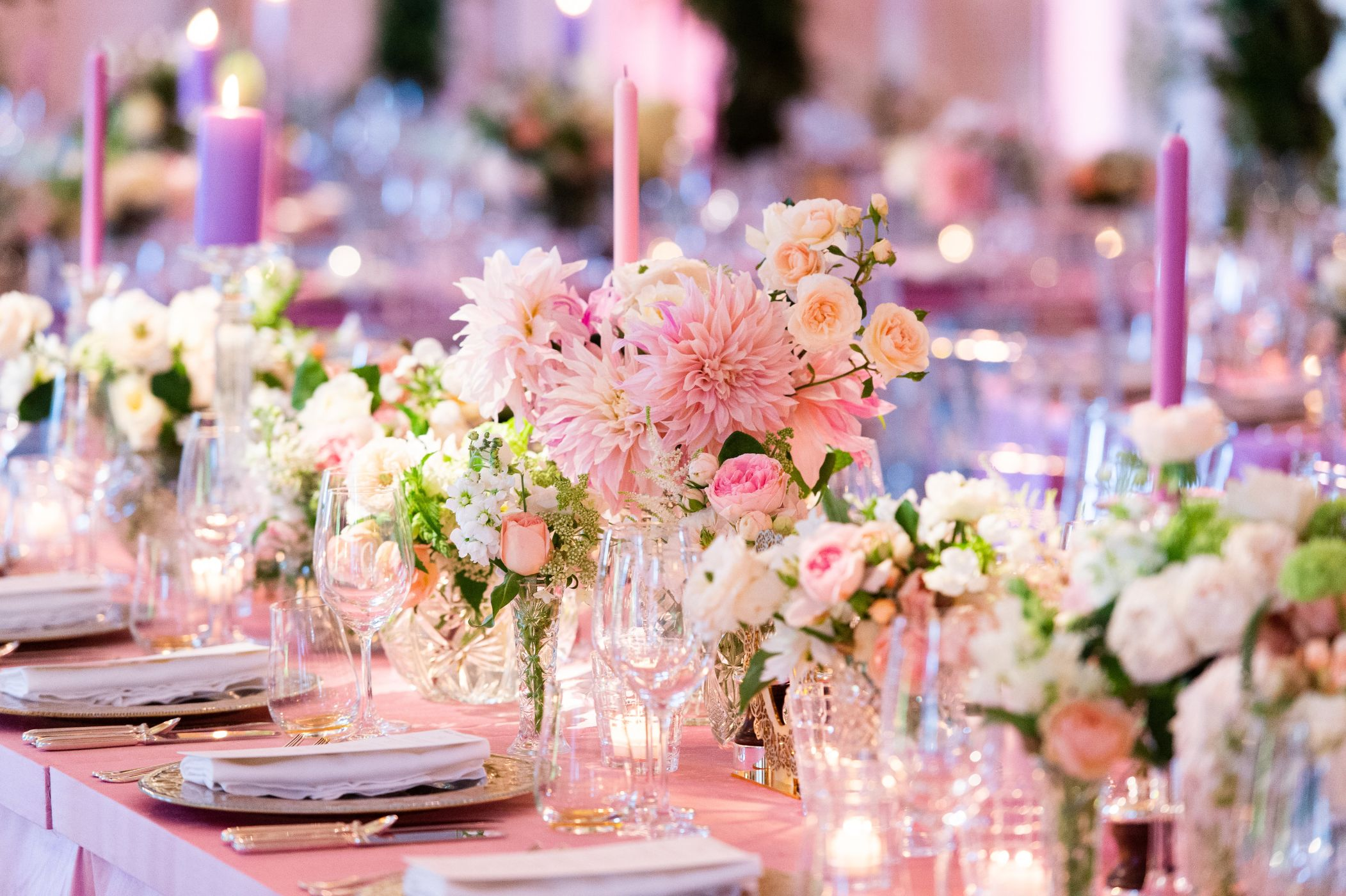 Floral table setting at wedding reception.