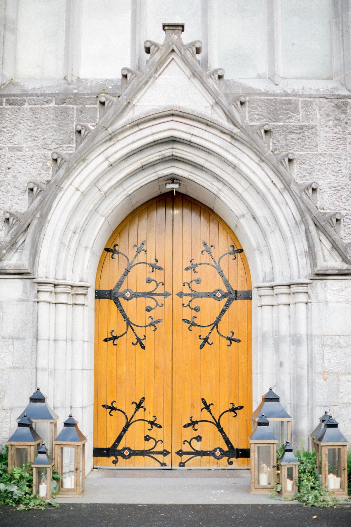 Church door with lanterns and greenery