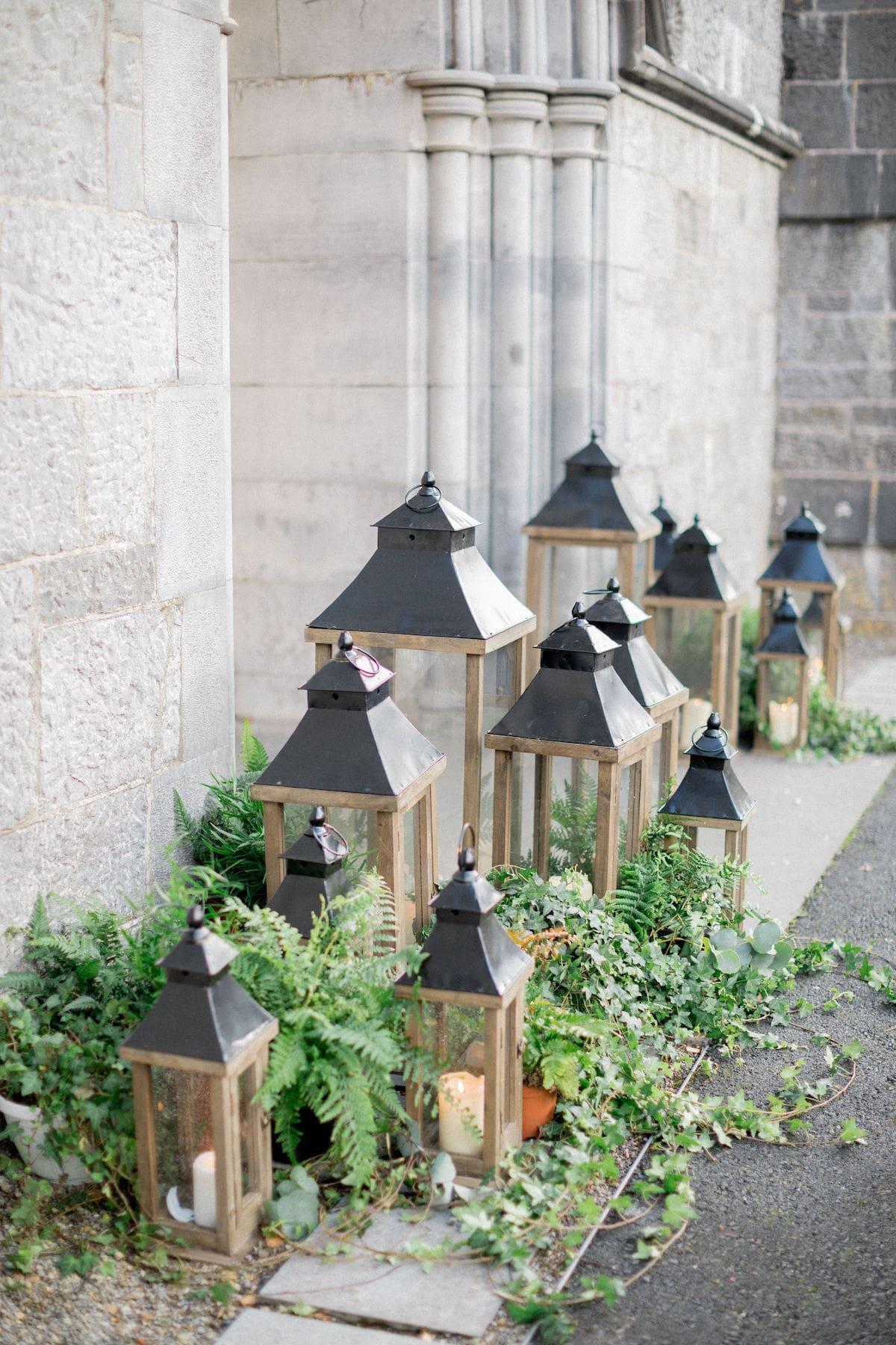 Lanterns and greenery church wedding ceremony décor