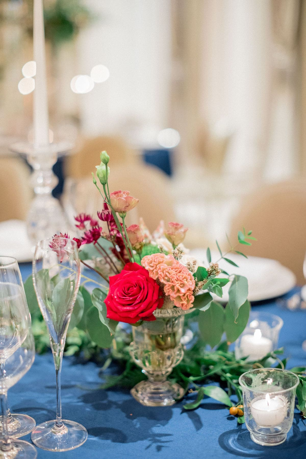 Small centerpiece with navy tablecloth wedding décor