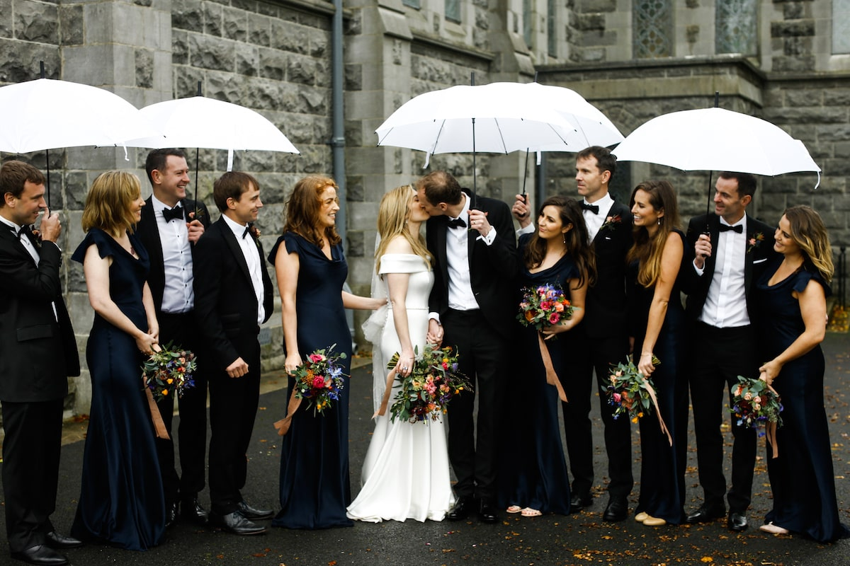 rainy wedding day bridal party