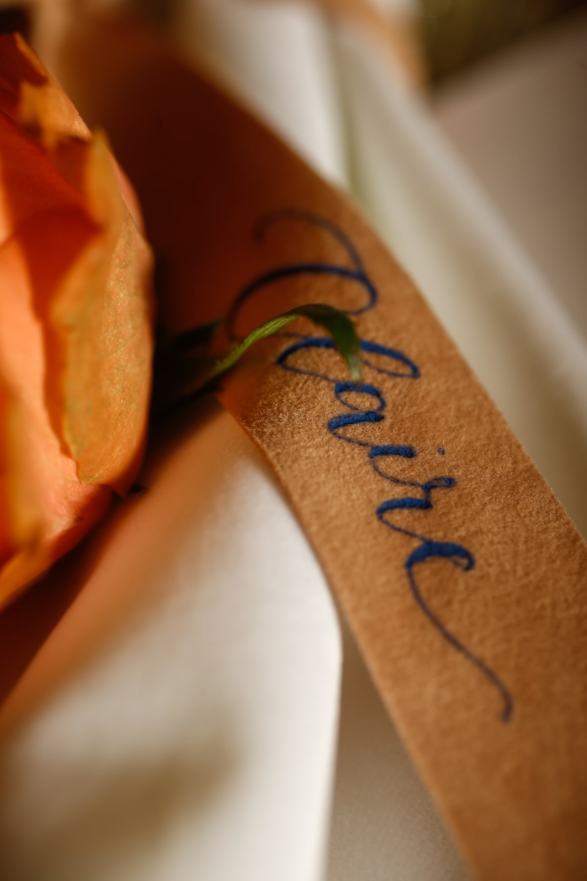 peach ribbon with calligraphy place card