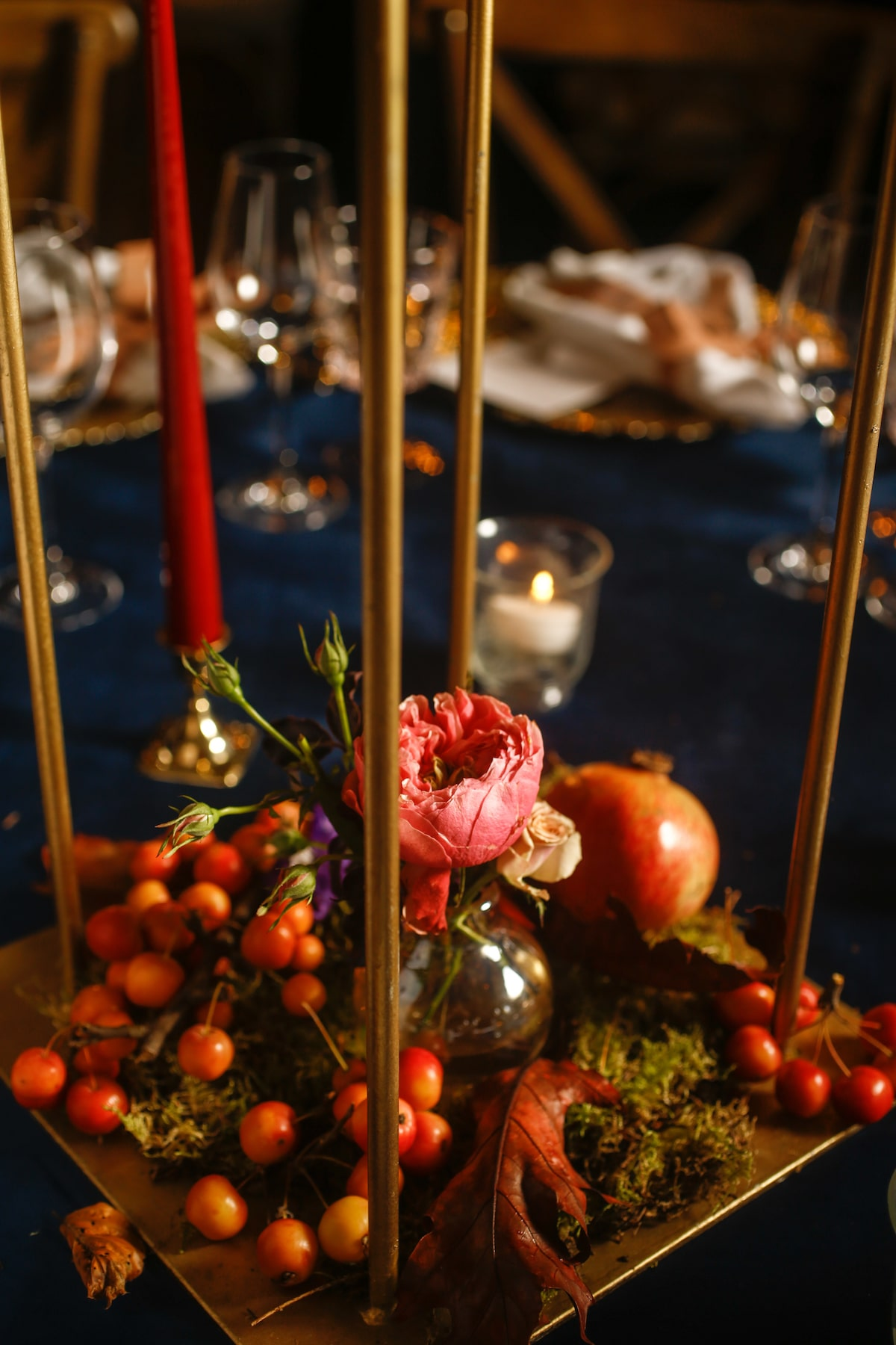 autumnal wedding centrepiece with pomegranate