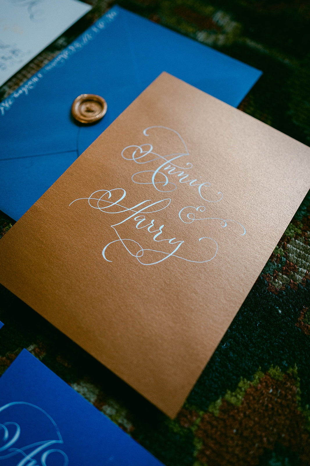 copper-wedding-invitation-with-white-calligraphy