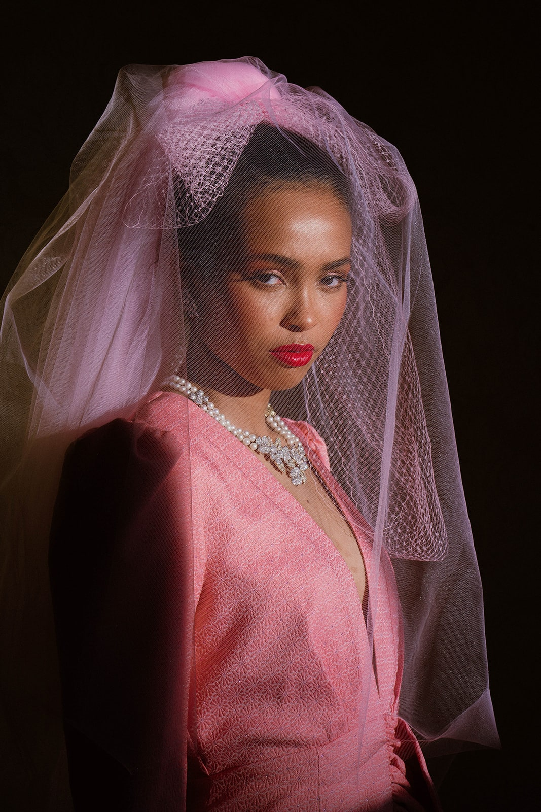 bride with pink veil and red lip