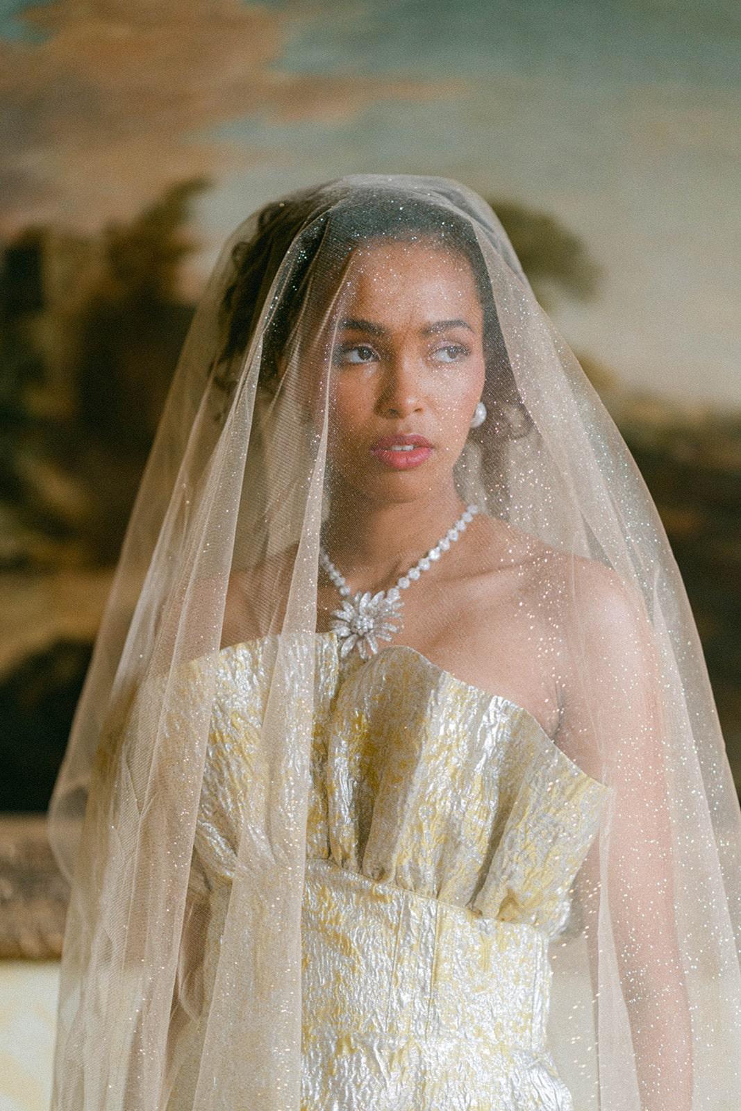 gold wedding dress with sparkle veil