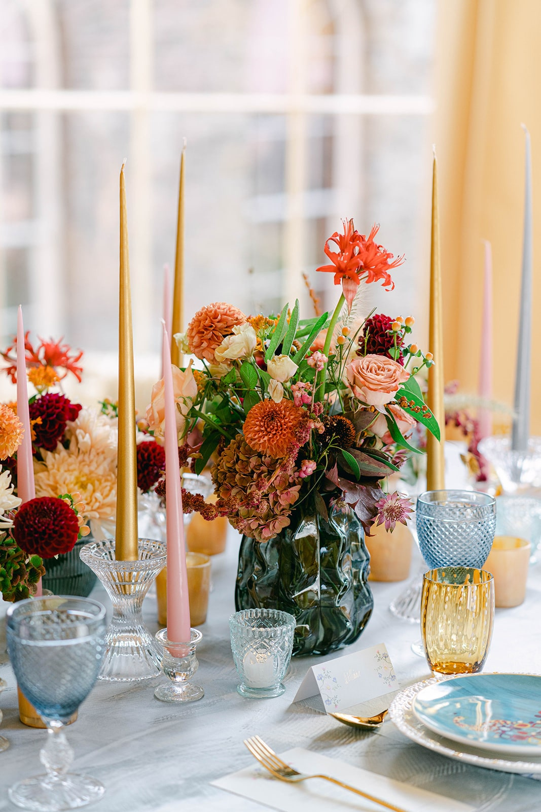 textured vases bright flowers centrepiece