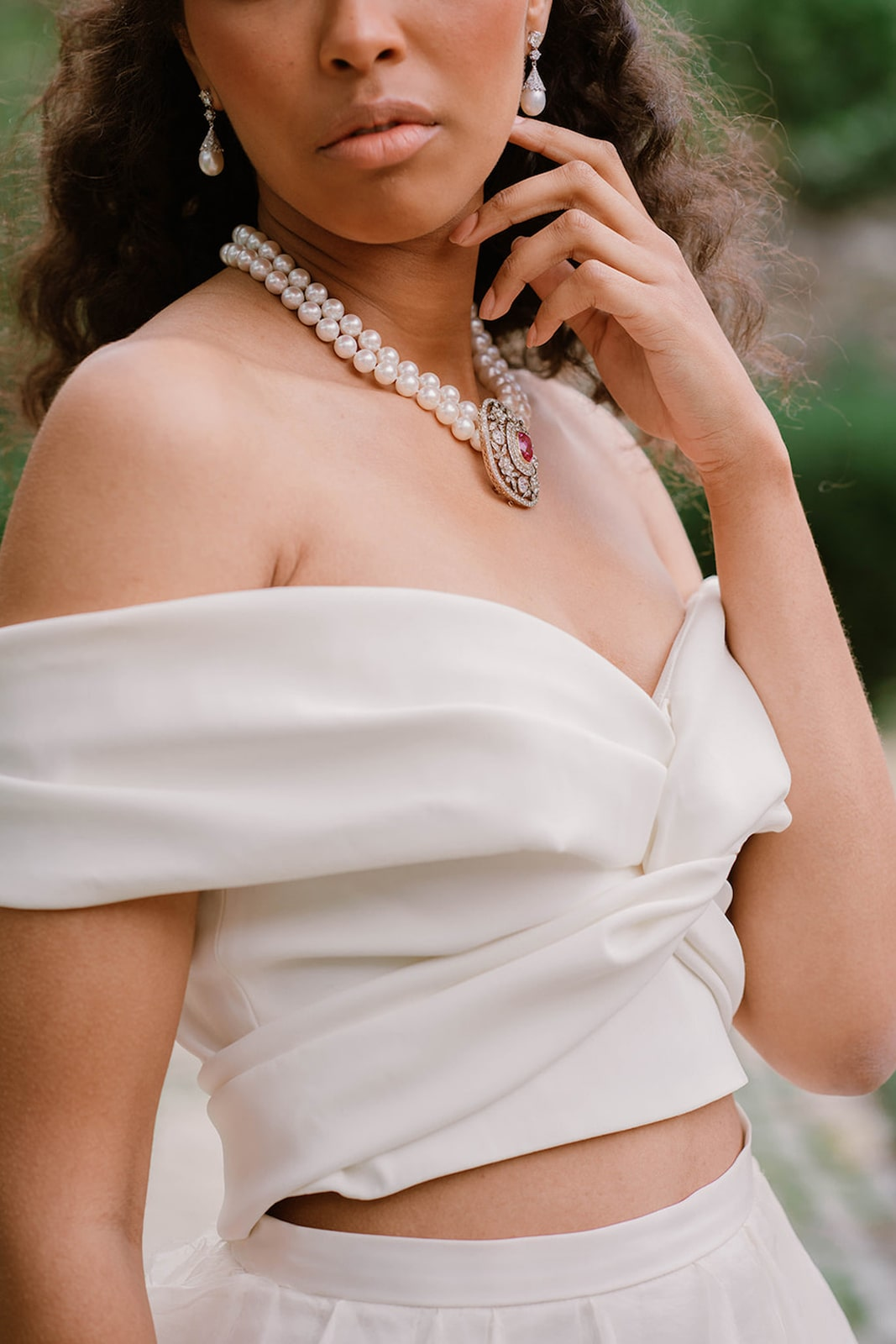 two-piece wedding dress with pearl necklace