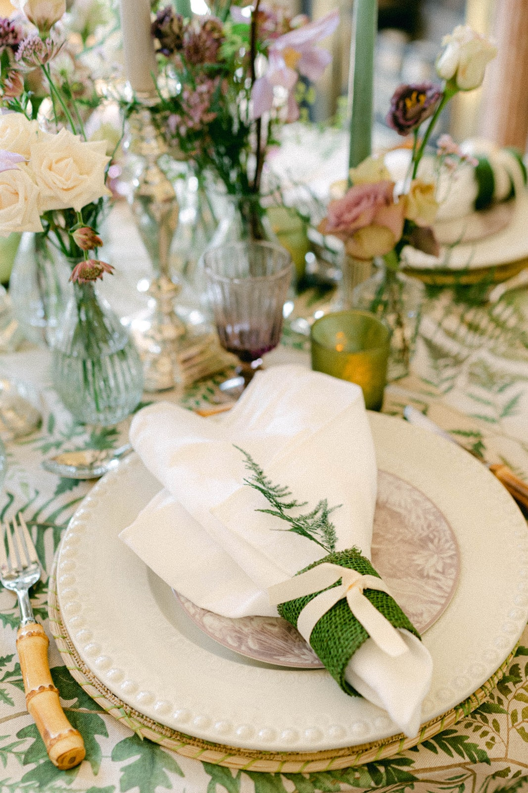 fern tied with burlap napkins place setting