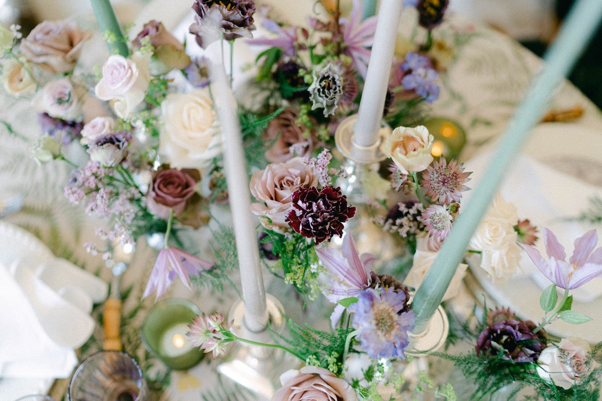 purple and cream florals for garden wedding centrepiece