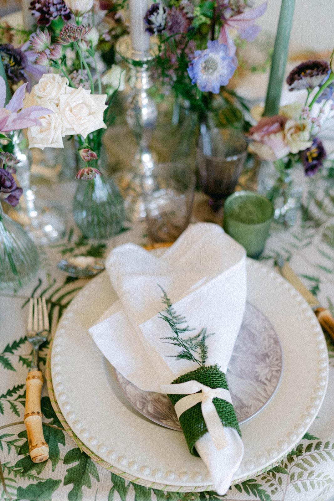 place setting for whimsical garden inspired wedding