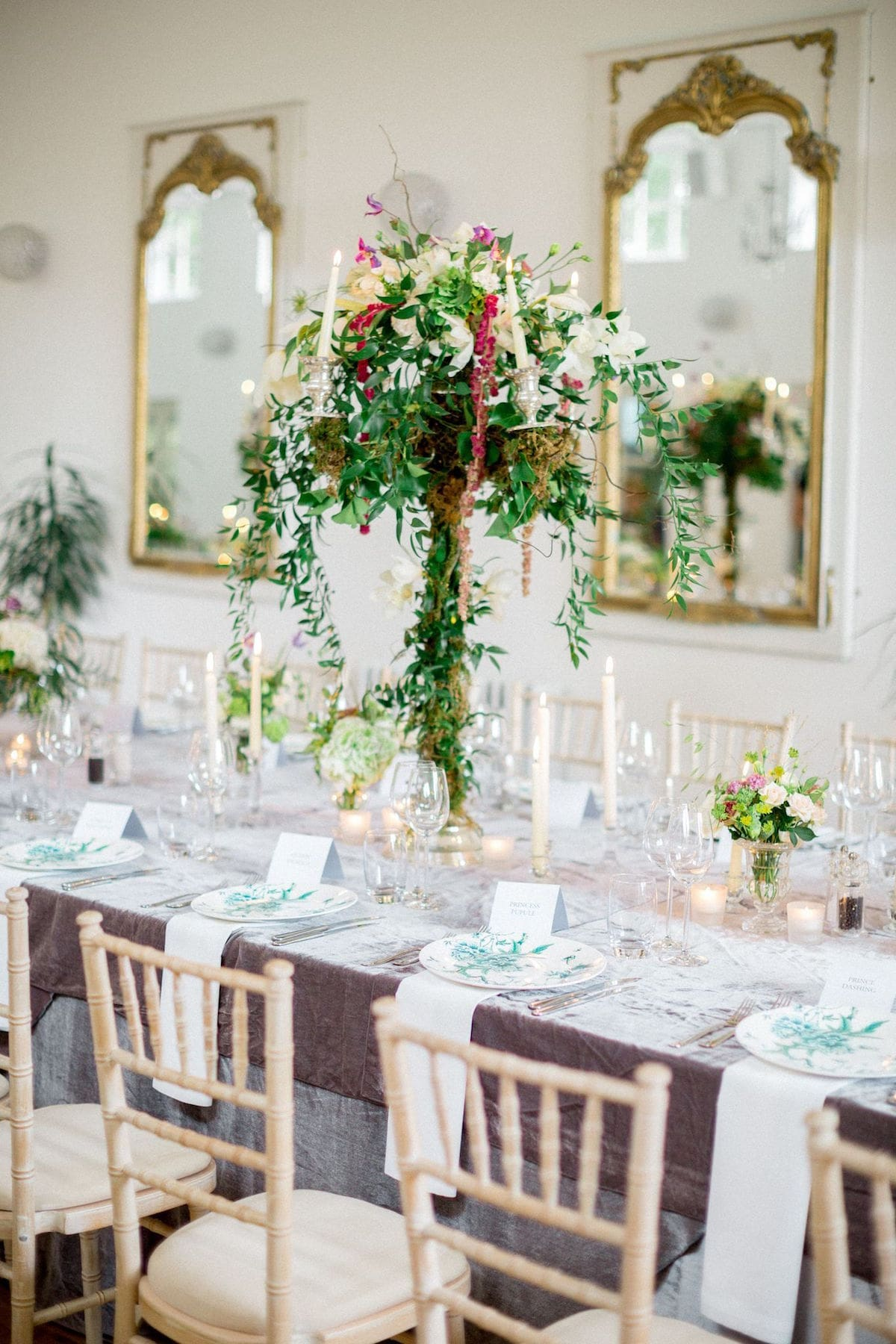 tall centrepiece with trailing greenery
