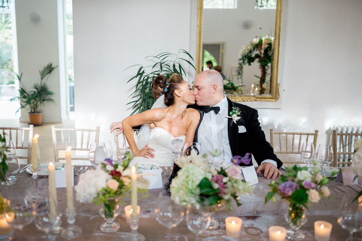 Gloster House wedding bride and groom kiss